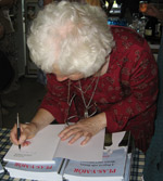 Ena signing a copy of Plas-y-Môr